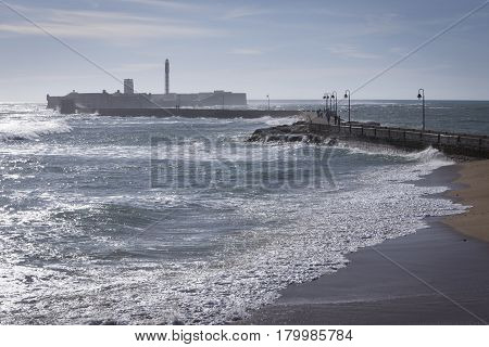 Cadiz Spain- April 1: Castle of San Sebastian fortress on a smail island separated from the main city according classical tradition there was a Temple of Kronos cultural landmark of the city Cadiz Spain