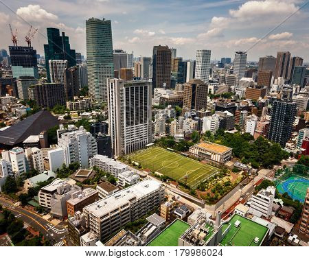 TOKYO JAPAN - JUNE 10: View at modern skyscrapers in Roppongi district in Minato Tokyo at June 10 2015. This district is well known as the city's most popular nightlife district.