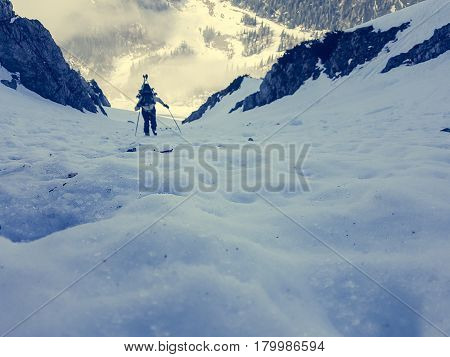 Steep icy slope with blurred alpinist. Extreme ice climbing.