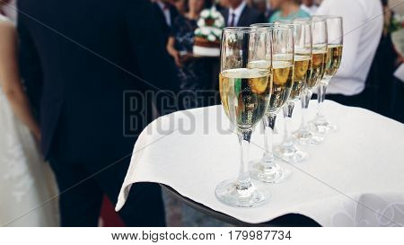 Elegant Dressed Waiter Holding Tray With Champagne In Glasses At Wedding Reception In Luxury Restaur