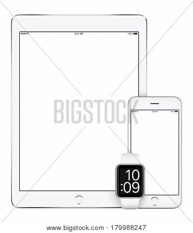 Responsive mockup consisting of vertical white tablet pc mobile smartphone and smart watch. All gadgets in focus. Isolated on white background. Technology set for responsive design presentation.