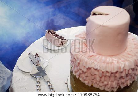 Slice Of Delicious Chocolate Wedding Cake With Gold Frosting And Pink Cream, Beautiful Decorated Wed