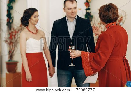 Mother In Law Pronouncing Toast To Happy Newlywed Couple, Woman With Champagne Glass Drinking To Bri