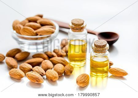natural cosmetic and therapeutic almond oil for treatment on white table background