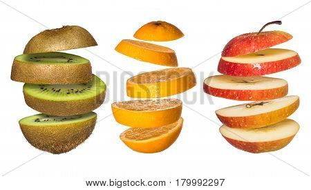 Set os Flying fruits. Sliced orange, kiwi, apple isolated on white. Levity fruit floating in the air