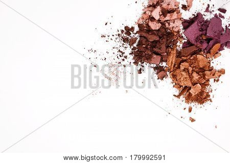 Makeup cosmetics. Eyeshadow crushed palette, colorful eye shadow powder on white background