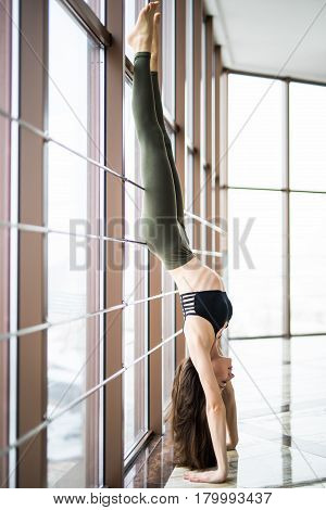 Woman Plank On Standing On Hands. Beautiful Yoga Woman Practice Near Window Yoga Room Studio Backgro