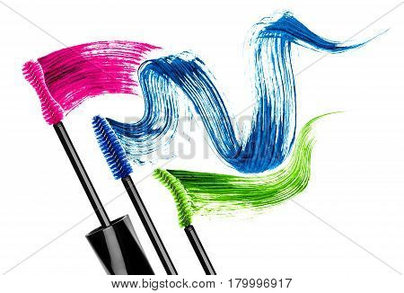 Mascara brushes with colored mascara strokes isolated on white background poster