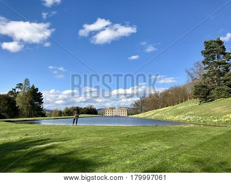 CHATSWORTH HOUSE - MARCH 31, 2017: The Canal Pond at Chatsworth House Estate in the Derbyshire Dales area of the Peak District, Derbyshire, UK.