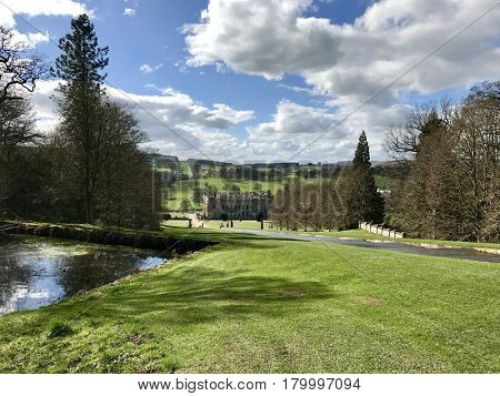 CHATSWORTH HOUSE - MARCH 31, 2017: The Cascade water feature in the gardens at Chatsworth House in the Derbyshire Dales area of the Peak District, Derbyshire, UK.