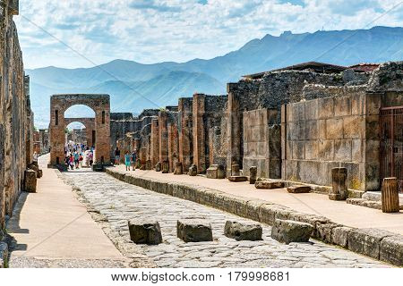POMPEII, ITALY - MAY 13, 2014: Ruins of a city. Pompeii is an ancient Roman city died from the eruption of Mount Vesuvius in 79 AD.
