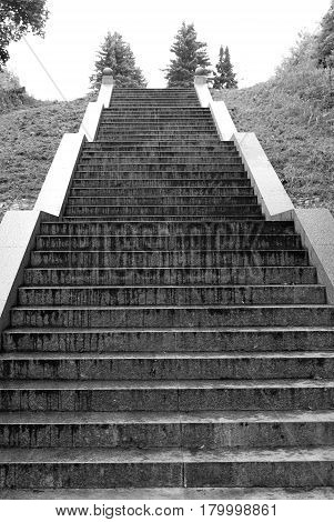 Vertical stone long staircase black and white.