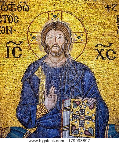 ISTANBUL - MAY 25, 2013: Ancient mosaic of Christ in Hagia Sophia. Church of Hagia Sophia is the greatest monument of Byzantine Culture. It was built in the 6th century.
