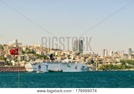 ISTANBUL- MAY 27, 2013: Huge cruise ship in the Bosphorus port. Istanbul is an interesting ancient city attracts many tourists.