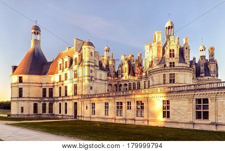 The royal Chateau de Chambord at sunset, France. This castle is located in the Loire Valley, was built in the 16th century and is one of the most recognizable chateaux in the world.