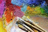 oil paints and paint brushes on a palette poster