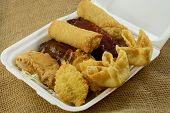 Chinese food take out Pu Pu Platter for two with cheese wontons, fantail shrimp, egg rolls, chicken wings, beef skewers, BBQ spare ribs poster