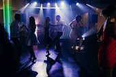 Fun dance party at nightclub after wedding reception guests and friends dancing on the floor night with lights disco concept poster