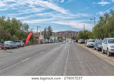 Williston, South Africa, August 31, 2018: A Street Scene, With Vehicles And Businesses, In Williston