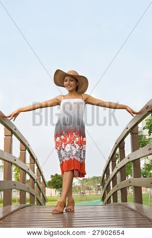 Woman on footbridge