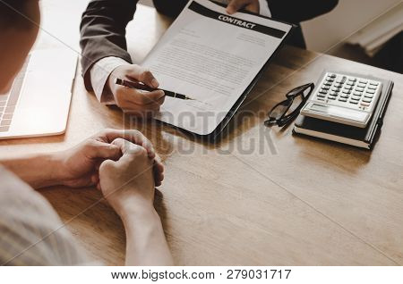 Realtor - Young Man Customer Signing Contract For Buying House With Real Estate Broker In Suit At Es