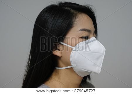 Woman Wearing Face Mask Of N95 Because Of Air Pollution In The City Have Particulate Matters Or Pm 2