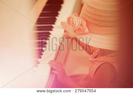 Kid In Vintage Pink Hat, Dress, Bead Necklace Play Digital Piano On Blurred Background. Music Class,