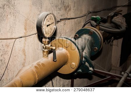 Water And Gas Pipeline With Pressure Indicator. Old Pressure Gauge.