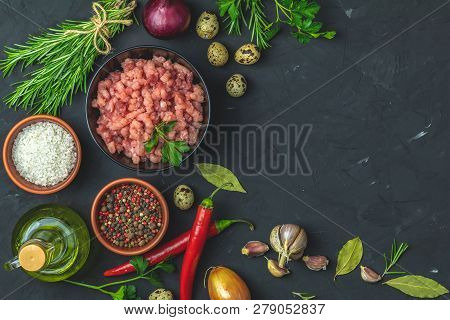 Homemade Minced Meat In A Black Bowl Over Dark Slate Or Stone Or Concrete Background With Ingredient
