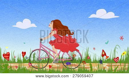 Beautiful Young Girl In Red Dress Riding Bike On Spring Flowering Field. Cobbled Path Through Bloomi