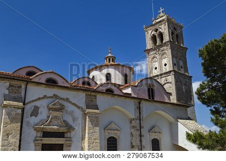 Ancient Church Of The Holy Cross ( Timios Stavros ) Outside Against The Blue Sky. Mountain Village P