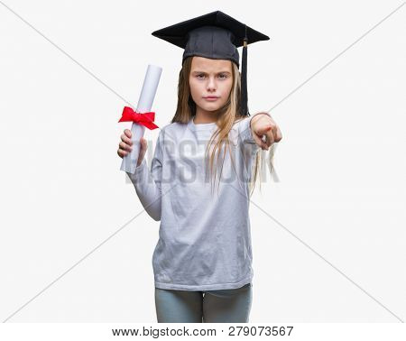 Young beautiful girl wearing graduate cap holding degree over isolated background pointing with finger to the camera and to you, hand sign, positive and confident gesture from the front