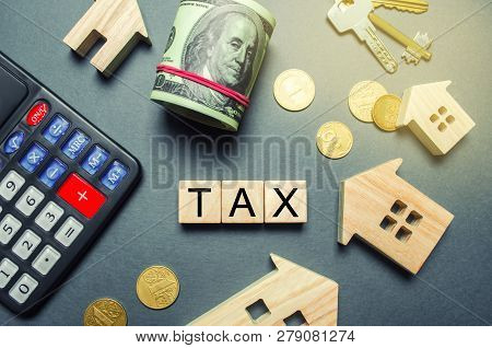 Wooden Houses, A Calculator, Keys, Coins And Blocks With The Word Tax. Property Taxes. Calculation O