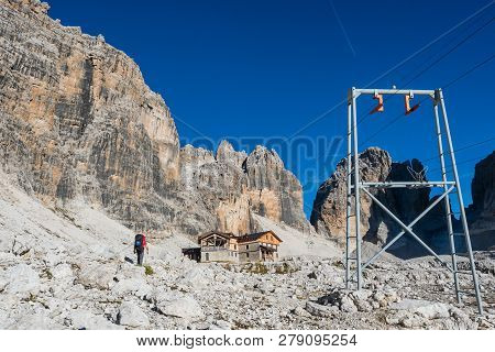 Tourist With Hiking Backpacks In Mountain Hike On Summer Day. Man Traveler Hiking In Beautiful Mount