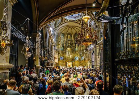Montserrat, Spain, April 23, 2017: People are gathered in the Basilica of Montserrat for L'Escolania Choir performance