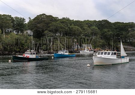 Anchored Lobster Boats In New Harbor, Maine - Usa