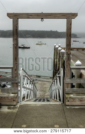 Ramp Down To Lower Dock - Focus On Anchored Boats - Maine, Usa