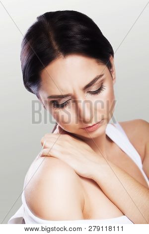 Muscle Pain. Shoulders A Young Woman Holds Her Hand Over Her Shoulders. Cold. Overfatigue. The Conce