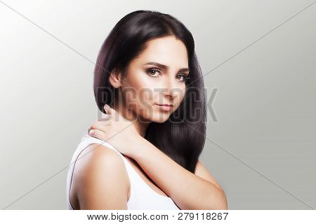 Shoulder Pain. The Woman Holds Two Hands Over The Neck And Shoulders. Dislocation. Cold. Muscle Tens