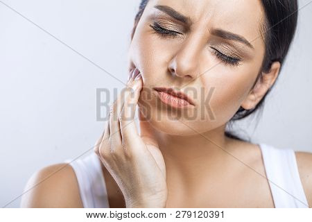 Teeth Problem. Woman Feeling Tooth Pain. Closeup Of Beautiful Sad Girl Suffering From Strong Tooth P