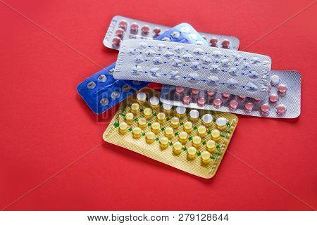 Contraceptive Pill Prevent Pregnancy Contraception Concept Birth Control On Red Background / Health