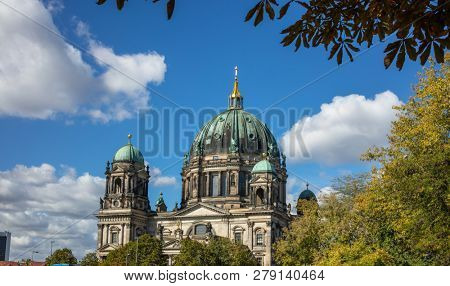 Berliner Dom, cathedral church on island museum in Berlin, Germany. Top part of monument, nature and blue sky background.
