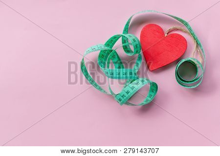 Obesity, Fat Kills Your Heart. Measuring Tape.overweight Kills The Heart. Concept Obesity. Copy Spac