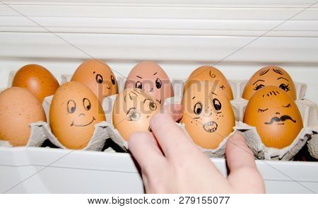 Eggs With Painted Emotions Egg Cell In The Refrigerator Hand Selects The Egg.egg Afraid, Psychology