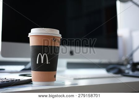 Minsk, Belarus - January 10, 2019 : Coffee In A Paper Cup Of Mcdonalds Illustrative Editorial