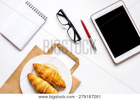 Business Lunch With Croissant And Tablet On White Table Top View