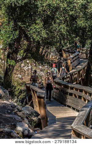 Arouca / Portugal - 10 12 2018 : View Of People Walking On Wooden Suspended Pedestrian Walkway, Over