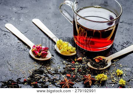 Teacup And Herbs On Dark Stone Background