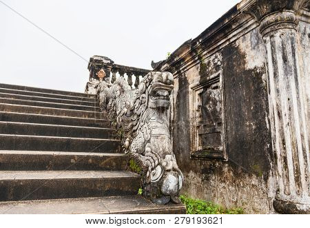 Hue, Vietnam. Stone Dragon Carved As Stair Handrail Is Ruins Of Kien Trung Palace At The Forbidden P