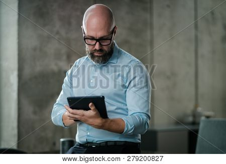 Middle-aged man with a tablet pc in an office